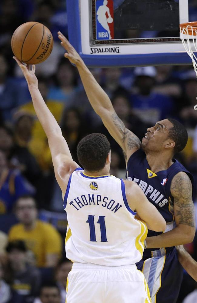 Memphis Grizzlies guard Courtney Lee, right, blocks a shot by Golden State Warriors guard Klay Thompson (11) during the first half of an NBA basketball game Friday, March 28, 2014, in Oakland, Calif