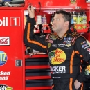 Tony Stewart looks at a monitor during practice for Sunday's NASCAR Sprint Cup series Coca-Cola 600 auto race at Charlotte Motor Speedway in Concord, N.C., Thursday, May 23, 2013. (AP Photo/Mike McCarn)