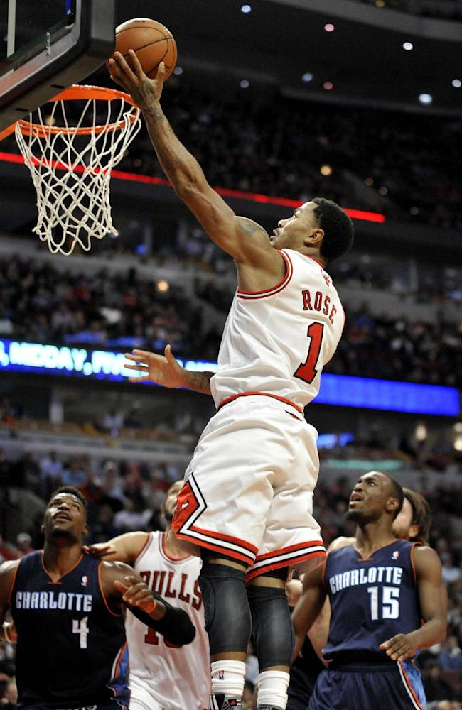 Chicago Bulls' Derrick Rose (1), goes up for a shot during the fourth quarter of an NBA basketball game against the Charlotte Bobcats in Chicago, Monday, Nov. 18, 2013. Chicago won 86-81