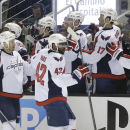 Washington Capitals' Joel Ward (42) celebrates his goal with teammates on the bench during the first period of an NHL hockey game against the San Jose Sharks, Saturday, March 22, 2014, in San Jose, Calif The Associated Press