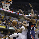 Indiana Pacers' George Hill (3) is fouled by Atlanta Hawks' Elton Brand as he goes up of a shot during the second half in Game 2 of an opening-round NBA basketball playoff series Tuesday, April 22, 2014, in Indianapolis. Indiana defeated Atlanta 101-85 Th