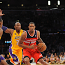 LOS ANGELES, CA - MARCH 22: Trevor Ariza #1 of the Washington Wizards drives against Kobe Bryant #24 of the Los Angeles Lakers at Staples Center on March 22, 2013 in Los Angeles, California. (Photo by Noah Graham/NBAE via Getty Images)