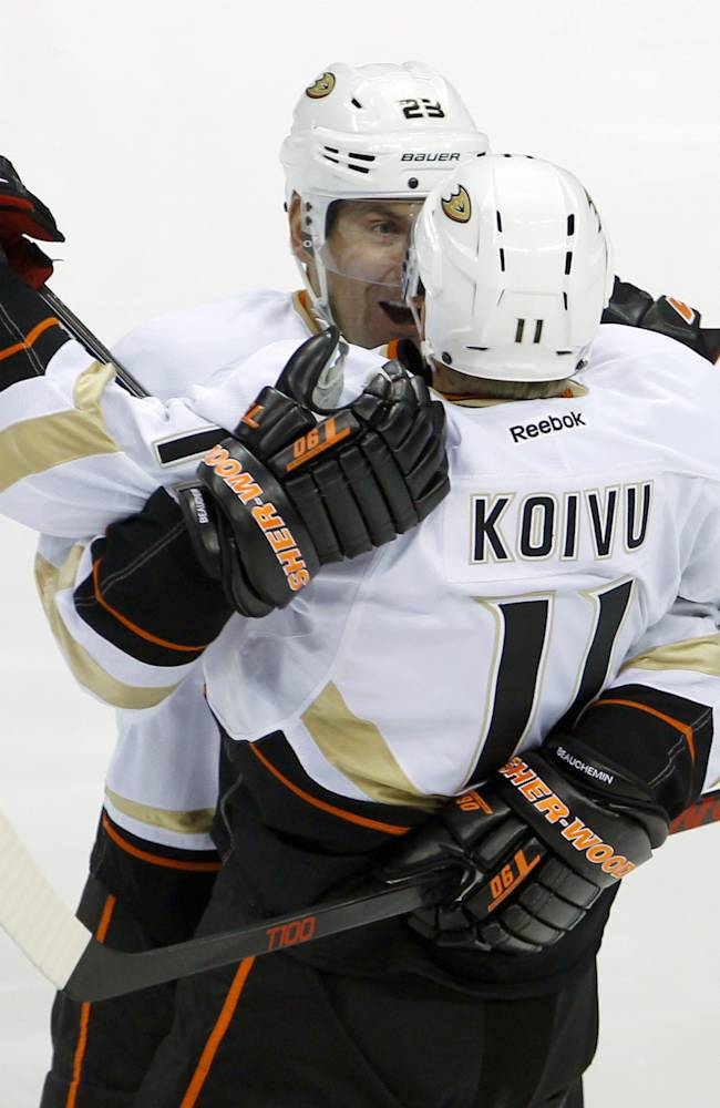 Anaheim Ducks defenseman Francois Beauchemin (23) congratulates center Saku Koivu (11), of Finland, on his goal against2 Minnesota Wild goalie Niklas Backstrom (32) during the first period of an NHL hockey game in St. Paul, Minn., Saturday, Oct. 5, 2013