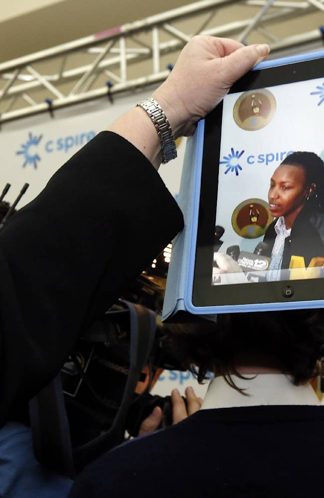 Southern Mississippi women's basketball coach Joye Lee-McNelis uses her smart tablet to record the comments of her guard Jamierra Faulkner, right, after winning the Gillom Trophy on Monday afternoon, March 3, 2014 at the Mississippi Sports Hall of Fame in Jackson, Miss. The award sponsored by C Spire Wireless, is given to Mississippi's best women's college basketball player