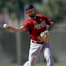 St. Louis Cardinals infielder Daniel Descalso throws to first during spring training baseball practice Sunday, Feb. 16, 2014, in Jupiter, Fla The Associated Press