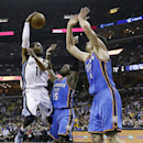 Memphis Grizzlies guard Mike Conley (11) passes around Oklahoma City Thunder defenders Reggie Jackson (15) and Nick Collison during the first half of Game 3 of an opening-round NBA basketball playoff series Thursday, April 24, 2014, in Memphis, Tenn The A