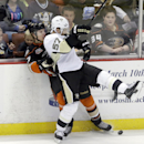 Anaheim Ducks defenseman Hampus Lindholm (47), of Sweden, and Pittsburgh Penguins center Marcel Goc (57), of Germany, tangle in the first period of an NHL hockey game in Anaheim, Calif., Friday, March 7, 2014 The Associated Press