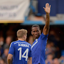 Chelsea's Didier Drogba waves to supporters, prior to a pre-season friendly soccer match against Real Sociedad, at Stamford Bridge, in London. Tuesday Aug. 12, 2014