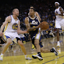 Utah Jazz guard Trey Burke, center, drives to the basket next to Golden State Warriors guard Steve Blake, left, during the second half of an NBA basketball game Sunday, April 6, 2014, in Oakland, Calif. Golden State won 130-102 The Associated Press