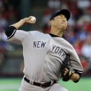 New York Yankees starting pitcher Hiroki Kuroda, of Japan, delivers to the Texas Rangers in the first inning of a baseball game Tuesday, April 24, 2012, in Arlington, Texas. (AP Photo/Tony Gutierrez)