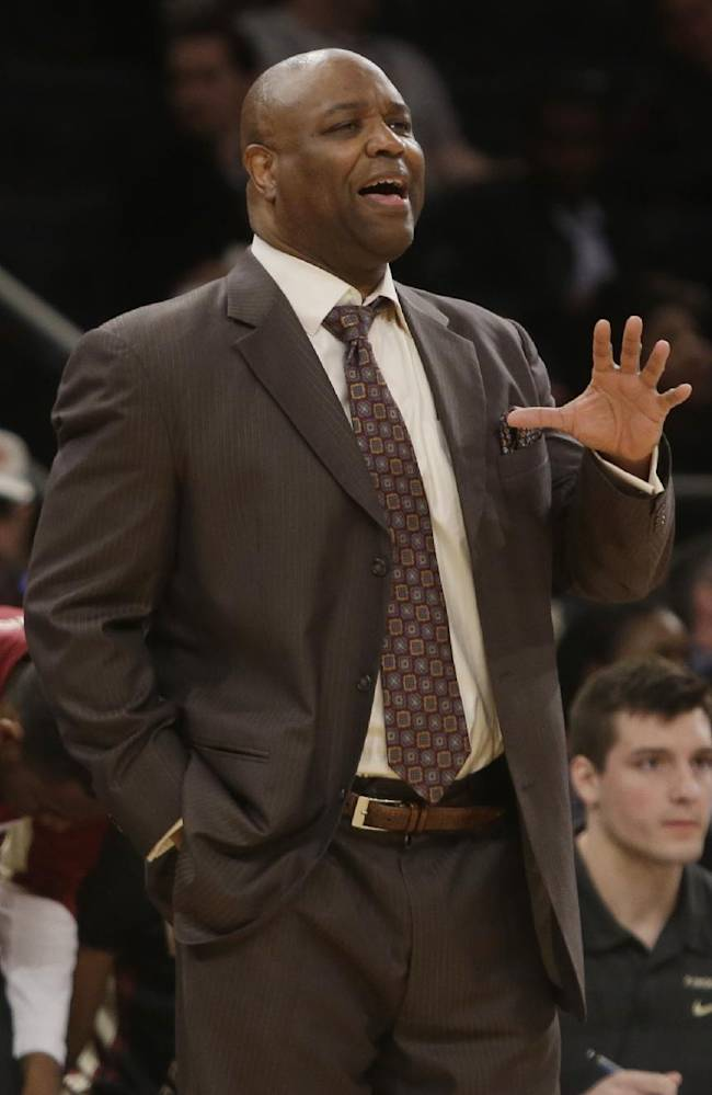 Florida State coach Leonard Hamilton calls out to his team during the second half of an NCAA college basketball game against Minnesota in the semifinals of the NIT on Tuesday, April 1, 2014, in New York. Minnesota won the game 67-64