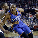 Oklahoma City Thunder guard Russell Westbrook, right, drives on Portland Trail Blazers guard Damian Lillard during the first half of an NBA basketball game in Portland, Ore., Wednesday, Dec. 4, 2013 The Associated Press