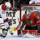 Chicago Blackhawks goalie Antti Raanta (31), right, blocks the puck hit by Montreal Canadiens right wing Dale Weise (22) during the first period of a preseason NHL hockey game in Chicago, Wednesday, Oct. 1, 2014 The Associated Press