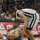 San Antonio Spurs forward Kawhi Leonard, right, and Orlando Magic guard Ronnie Price, fight for the loose ball during the first half of an NBA basketball game on Saturday, March 8, 2014, in San Antonio. (AP Photo/Darren Abate)
