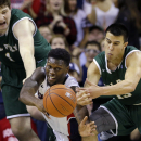 Gonzaga's Gary Bell Jr., center, reaches for the ball between Cal Poly's Aleks Abrams, left, and Kyle Toth in the first half of an NCAA basketball game Saturday, Dec. 20, 2014, in Seattle. (AP Photo/Elaine Thompson)