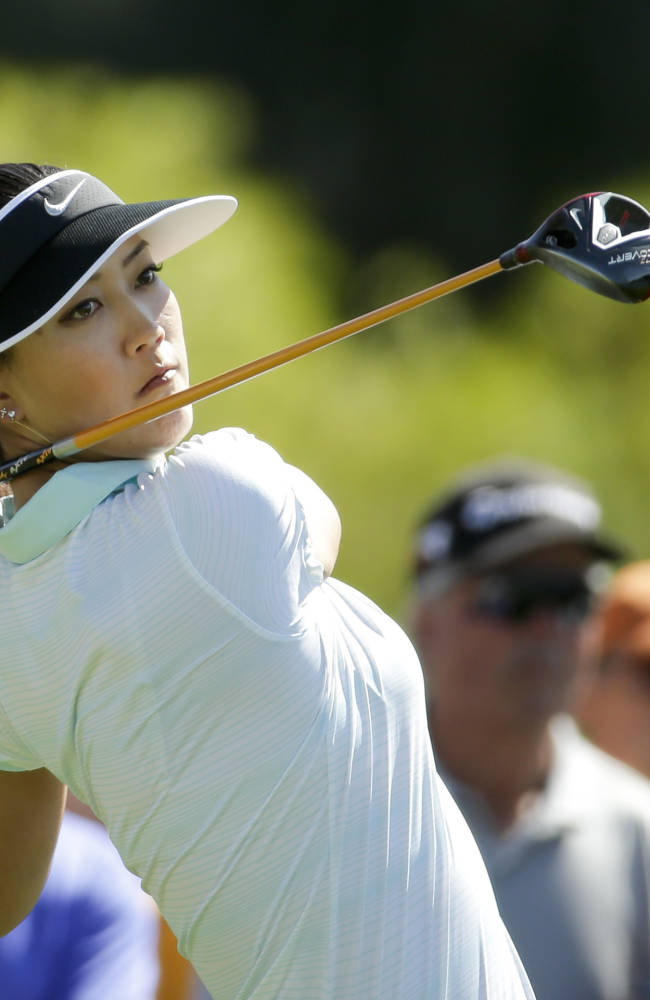 Michelle Wie watches her tee shot on the sixth hole during the final round of the Kraft Nabisco Championship golf tournament Sunday, April 6, 2014 in Rancho Mirage, Calif