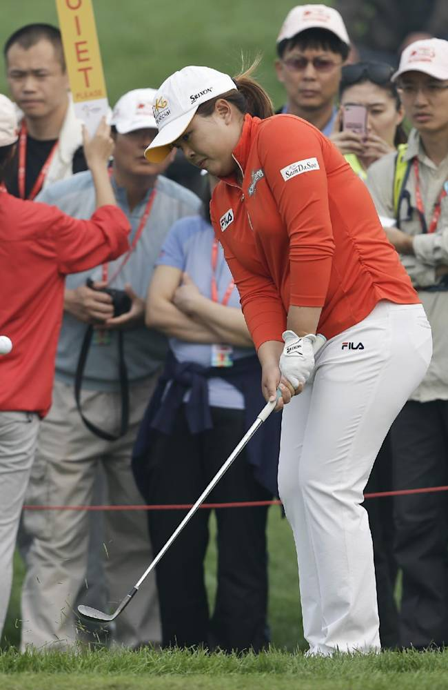 South Korea's Inbee Park chips a ball onto the forth green during the third round of the Reignwood LPGA Classic golf tournament at Pine Valley Golf Club on the outskirts of Beijing, China, Saturday, Oct. 5, 2013