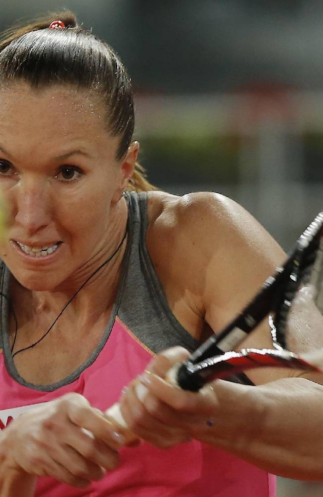 Jelena Jankovic from Serbia returns the ball during a Madrid Open tennis tournament match against Anastasia Pavlyuchenkova from Russia  in Madrid, Spain, Thursday, May 8, 2014
