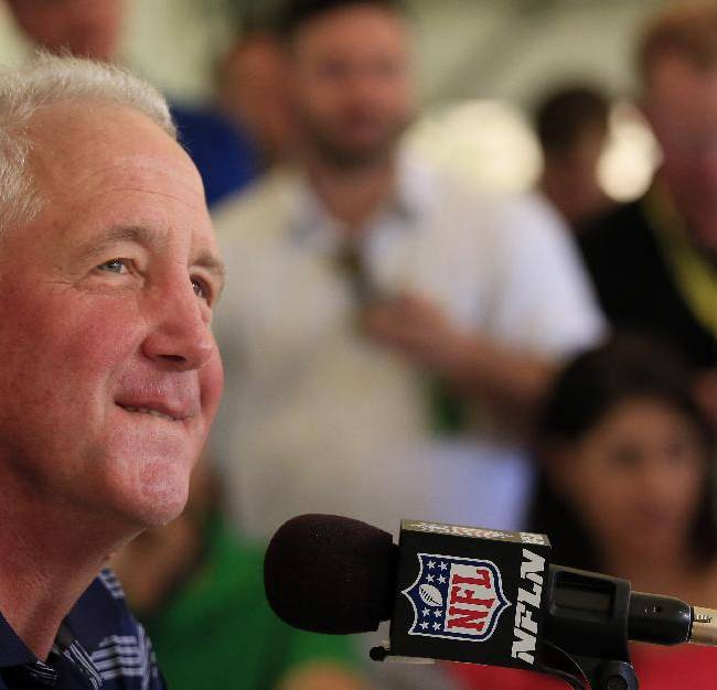 Denver Broncos head coach John Fox talks to the media during a news conference announcing that Broncos owner Pat Bowlen is giving up control of the team because of Alzheimer's disease, Wednesday, July 23, 2014, at the teams headquarters in Englewood, Colo
