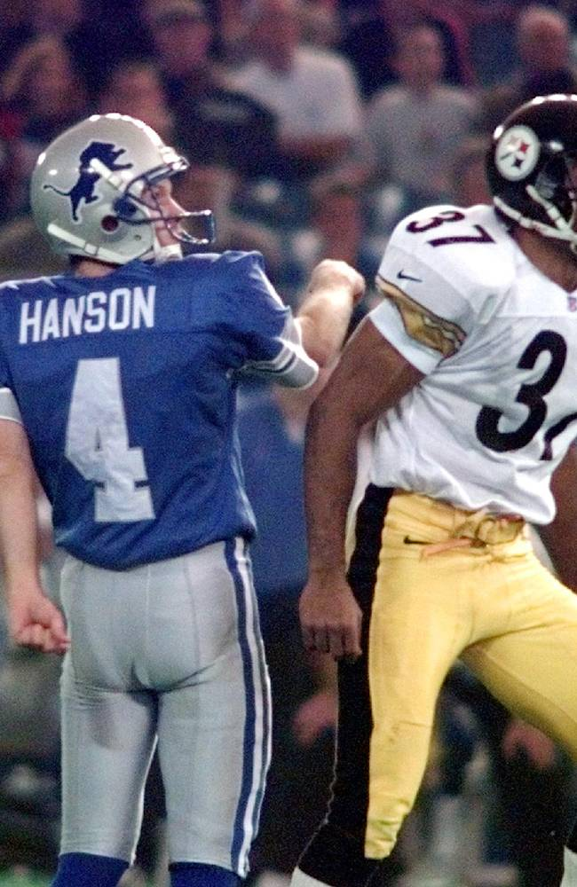 In this Thursday, Nov. 26, 1998, file photo, Detroit Lions kicker Jason Hanson (4) watches his game-winning field goal in overtime with Pittsburgh Steelers cornerback Carnell Lake (37) during an NFL football game at the Silverdome in Pontiac, Mich. After a Lions rally to send game in to overtime, the coin toss was held to determine possession. Steelers Jerome Bettis begins to call