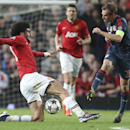Manchester United's Marouane Fellaini, left, and Bayern's Philipp Lahm challenge for the ball during the Champions League quarterfinal first leg soccer match between Manchester United and Bayern Munich at Old Trafford Stadium, Manchester, England, Tuesday