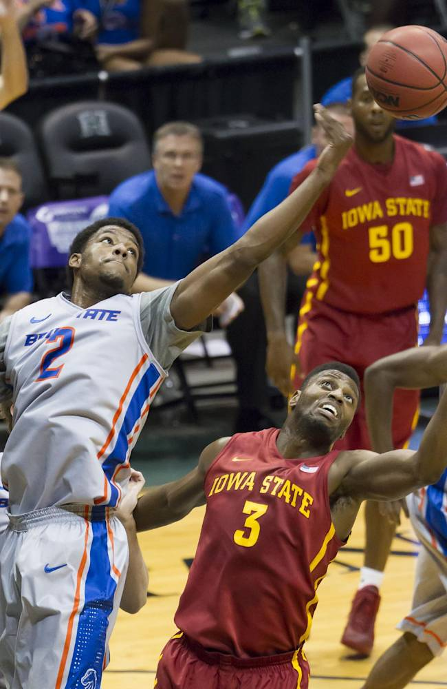 Boise State guard Derrick Marks (2) reaches out for rebound above Iowa State forward Melvin Ejim (3) during the first half of an NCAA college basketball game at the Diamond Head Classic on Wednesday, Dec. 25, 2013, in Honolulu