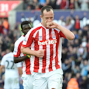 Stoke City's Charlie Adam celebrates after scoring against Swansea City during their English Premier League soccer match at the Britannia Stadium, Stoke, England, Sunday, Oct. 19, 2014