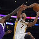 Los Angeles Lakers forward Xavier Henry, right, puts up a shot as Sacramento Kings forward John Salmons defends during the first half of an NBA basketball game Sunday, Nov. 24, 2013, in Los Angeles The Associated Press