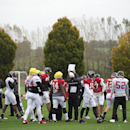 Atlanta Falcons check a play during a training session at the Arsenal FC training ground in London Colney, England, Wednesday Oct. 22, 2014. The Falcons will play the Detroit Lions in an NFL football game at London's Wembley Stadium on Sunday, Oct. 26 The