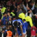 Chelsea's Gary Cahill remains on the pitch following their English Premier League soccer match against Sunderland at the Stamford Bridge ground in London, Saturday, April 19, 2014. Sunderland won the match 2-1. (AP Photo/Lefteris Pitarakis)