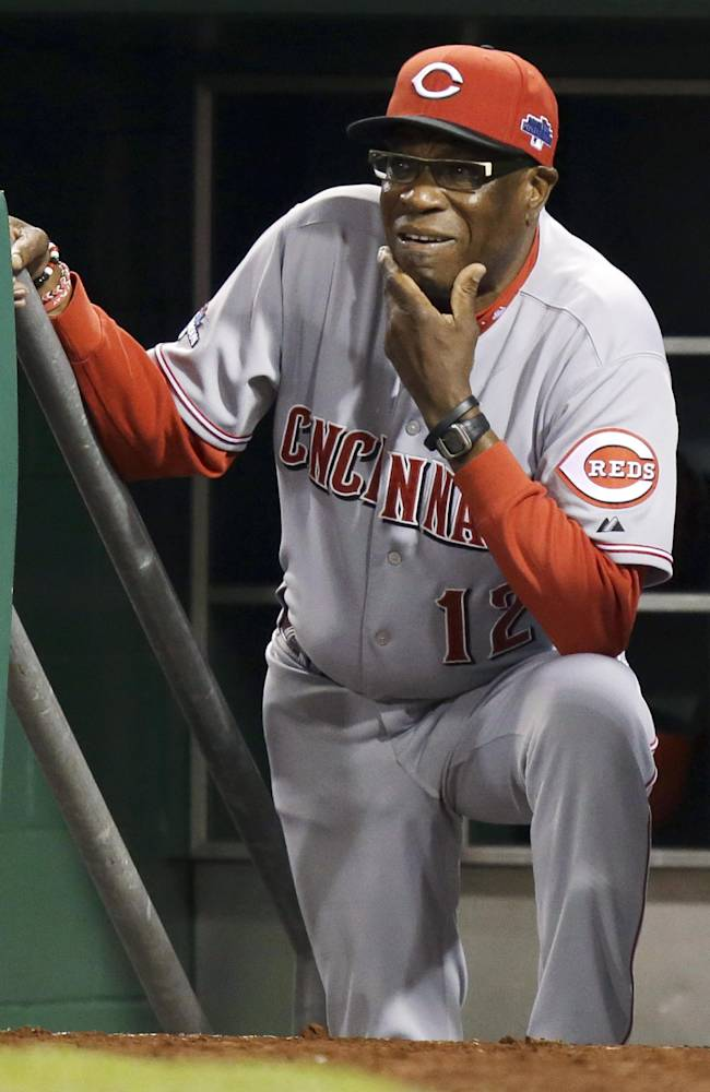 Cincinnati Reds manager Dusty Baker watches from the dugout steps as the Pittsburgh Pirates bat in the fifth inning of the NL wild-card playoff baseball game Tuesday, Oct. 1, 2013, in Pittsburgh