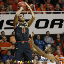 Maryland guard Jared Nickens (11) shoots over Oklahoma State guard Jeff Newberry (22) in the second half of an NCAA college basketball game in Stillwater, Okla., Sunday, Dec. 21, 2014. Maryland won 73-64. (AP Photo/Sue Ogrocki)