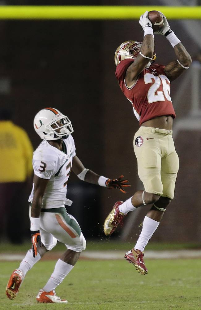 Florida State defensive back P.J. Williams (26) intercepts a pass intended for Miami wide receiver Stacy Coley (3) during the third quarter of an NCAA college football game Saturday, Nov. 2, 2013, in Tallahassee, Fla