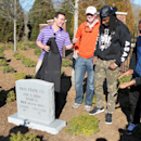 Clemson coach Dabo Swinney, left, applauds as former players, from left, Phillip Fajgenbaum, Chandler Catanzaro, Quandon Christian and Tajh Boyd unveil a tombstone on Wednesday, March 5, 2014, in Clemson, S.C., recognizing the Tigers' NCAA college footbal