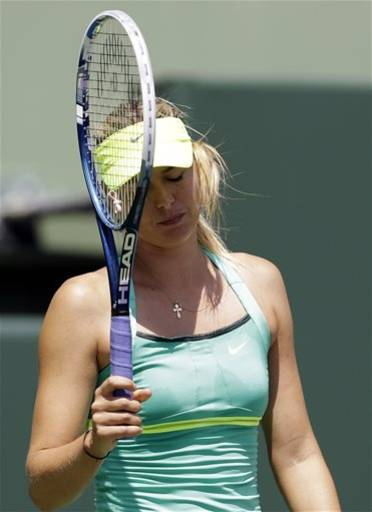 Maria Sharapova, of Russia, reacts after losing a point to Serena Williams during the final match of the Sony Open tennis tournament, Saturday, March 30, 2013, in Key Biscayne, Fla. Williams won 4-6, 6-3, 6-0