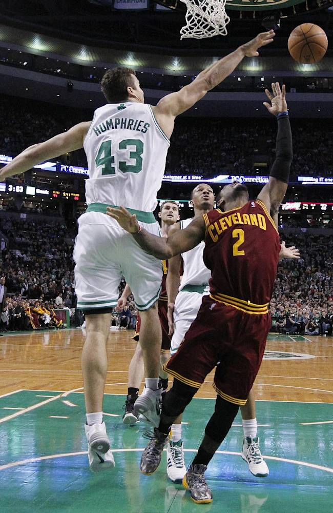 Boston Celtics' Kris Humphries (43) blocks a shot by Cleveland Cavaliers' Kyrie Irving (2) duringn the fourth quarter of an NBA basketball game in Boston, Saturday, Dec. 28, 2013. The Celtics won 103-100
