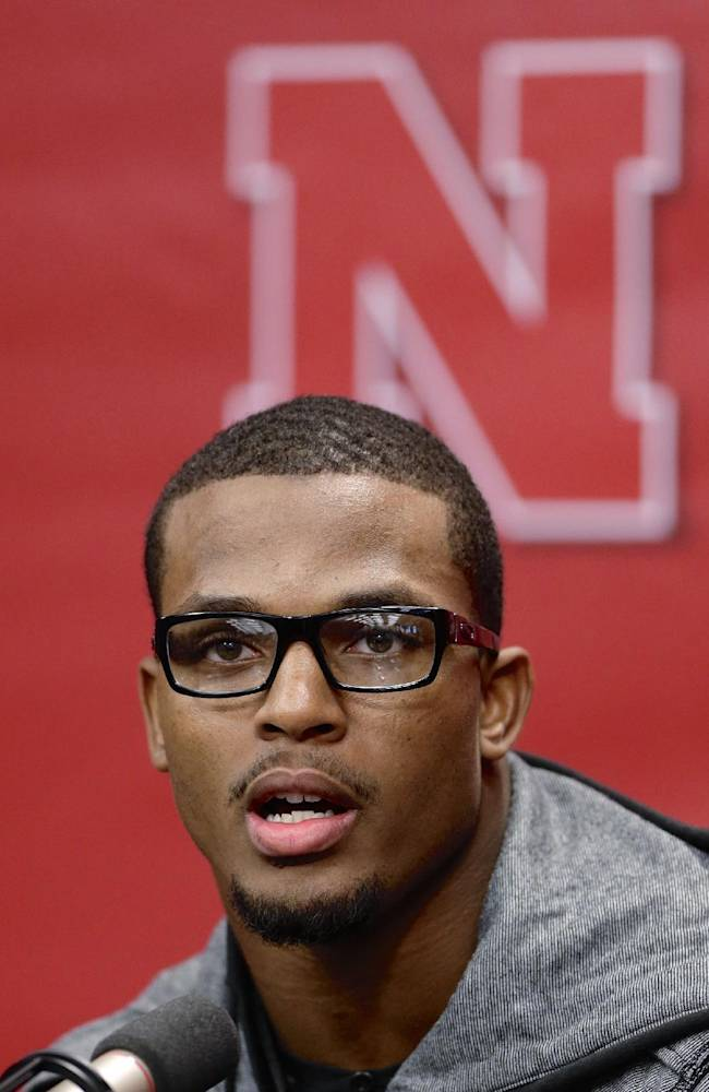 Nebraska running back Ameer Abdullah speaks during a news conference in Lincoln, Neb., Thursday, Jan. 16, 2014. Abdullah said he wanted to finish his education before he starts his pro football career. That's why he's returning to Nebraska instead of declaring for the NFL draft after his junior season