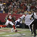 In this Aug. 23, 2014, file photo, Atlanta Falcons wide receiver Roddy White (84) waits for the ball as back judge Tony Steratore throws a penalty flag against the Tennessee Titans during the first half of an NFL preseason football game in Atlanta. There