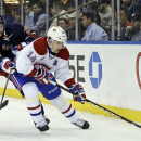 New York Rangers center Derek Stepan (21) and Montreal Canadiens center Tomas Plekanec (14) battle for the puck during the first period of an NHL hockey game Thursday, Jan. 29, 2015, at Madison Square Garden in New York The Associated Press