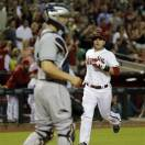 Arizona Diamondbacks' Miguel Montero, right, scores on a double by teammate Martin Prado as San Diego Padres' catcher Nick Hundley looks on during the seventh inning of a baseball game, Friday, May 24, 2013, in Phoenix. (AP Photo/Matt York)