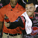 Austin Dillon celebrates in Victory Lane after winning the NASCAR Xfinity series auto race at Daytona International Speedway, Saturday, July 4, 2015, in Daytona Beach, Fla. (AP Photo/John Raoux)