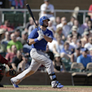 Kansas City Royals' Mike Moustakas hits a three-run home run as Arizona Diamondbacks catcher Miguel Montero, left, looks on during the fifth inning of an exhibition spring training baseball game Wednesday, March 5, 2014, in Scottsdale, Ariz The Associated
