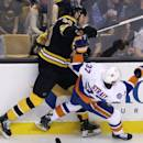 New York Islanders defenseman Brian Strait (37) collides with New York Islanders' Zdeno Chara during the first period of an NHL hockey game in Boston, Thursday, Oct. 23, 2014. Chara left the game during the first period for unspecified reasons, according to team officials. (AP Photo/Charles Krupa)
