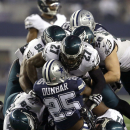 Dallas Cowboys running back Lance Dunbar (25) is stopped on a run by Philadelphia Eagles' Fletcher Cox (91), Trent Cole (58), Malcolm Jenkins (27) and Casey Matthews (50) during the second half of an NFL football game, Thursday, Nov. 27, 2014, in Arlingto