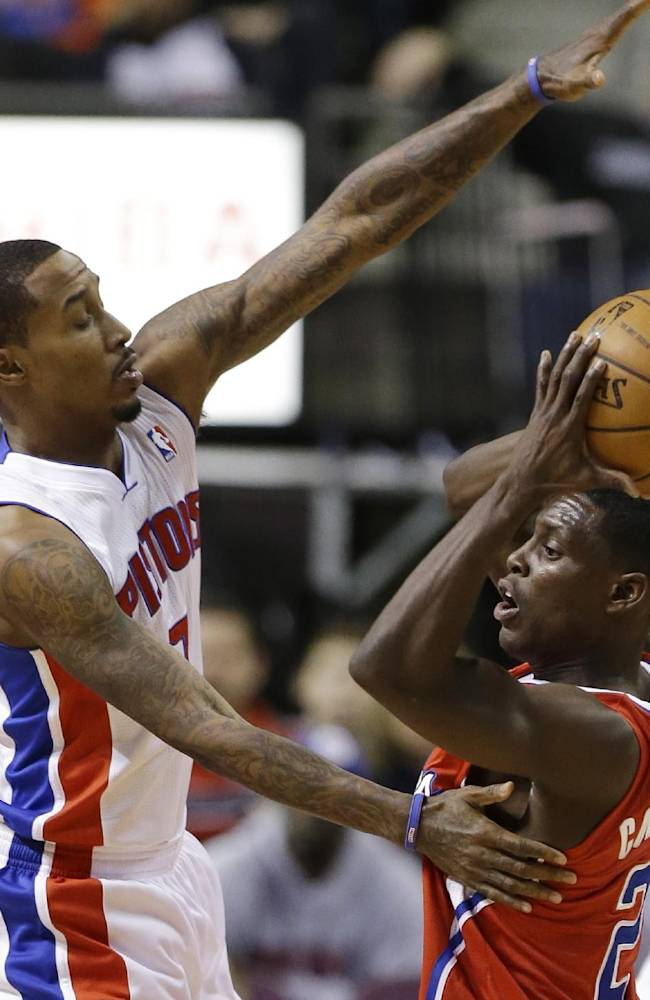 Los Angeles Clippers point guard Darren Collison (2) looks to pass around Detroit Pistons point guard Brandon Jennings (7) during the first half of an NBA basketball game in Auburn Hills, Mich., Monday, Jan. 20, 2014