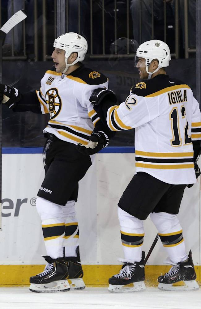 Boston Bruins' Milan Lucic, left, celebrates his goal with teammate Jarome Iginla during the third period of an NHL hockey game against the New York Rangers Sunday, March 2, 2014, in New York. The Bruins defeated the Rangers 6-3