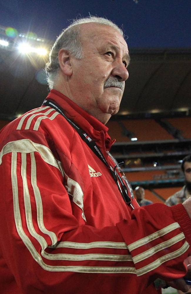 Spain's soccer head coach is Vicente del Bosque, looks on as they arrive for their training at Soccer City Stadium in Johannesburg, South Africa, Monday, Nov. 18, 2013. Spain will play their friendly international soccer match against South Africa on Wednesday, Nov. 19, 2013