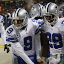 Dallas Cowboys quarterback Tony Romo (9) and Dallas Cowboys running back DeMarco Murray (29) warm their hands with heater on the sideline during the first half of an NFL football game against the Chicago Bears, Monday, Dec. 9, 2013, in Chicago The Associa
