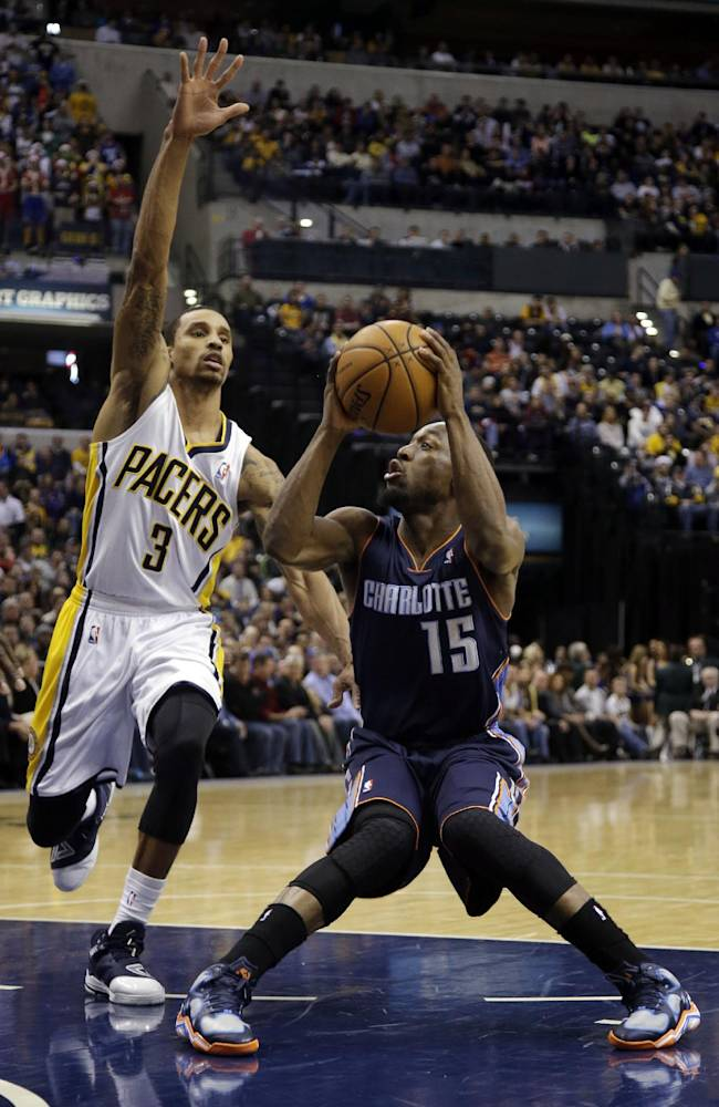 Charlotte Bobcats guard Kemba Walker (15) pulls up to shoot in front of Indiana Pacers guard George Hill (3) during the first half of an NBA basketball game in Indianapolis, Friday, Dec. 13, 2013