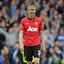 Manchester United's Darren Fletcher shows his dejection at the end of their English Premier League soccer match against Everton at Goodison Park in Liverpool, England, Sunday April 20, 2014
